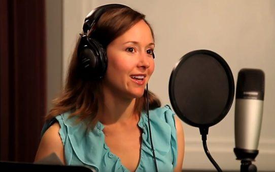 Women is in audio studio.